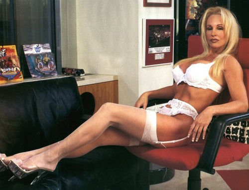 Frühere WWE-Diva… Debra Hintergrund containing bare legs called Debra - A Tag at the Office