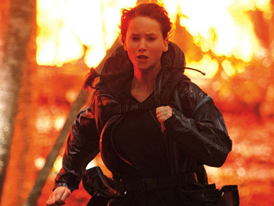 The Hunger Games wallpaper probably with a box coat, a hip boot, and an overgarment entitled Girl On Fire