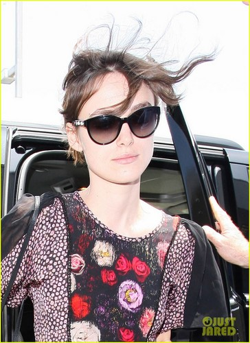 Keira Knightley keeps a low Profil as she steps out of a car and into LAX Airport on Wednesday