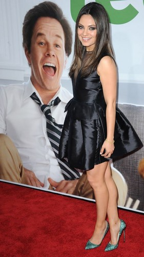 "Mila Kunis kertas dinding probably with a hip boot called Mila Kunis & Mark Wahlberg Premiere ""Ted"" in Hollywood"
