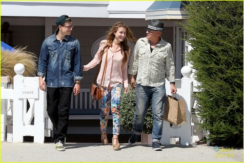 Nathalia with her brother and father