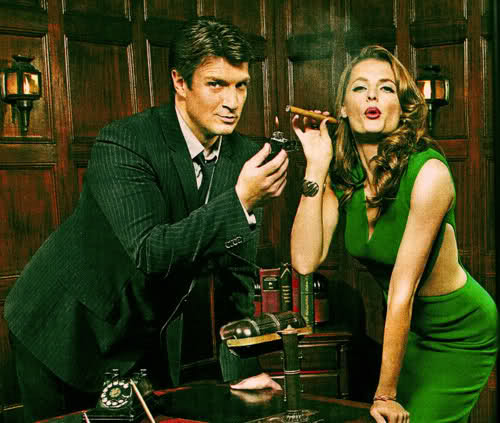 Nathan Fillion 바탕화면 probably with a business suit and a well dressed person entitled Nathan Fillion & Stana Katic