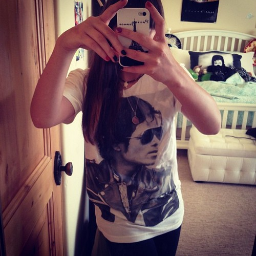 Paris has a t-shirt with her daddy's face on it