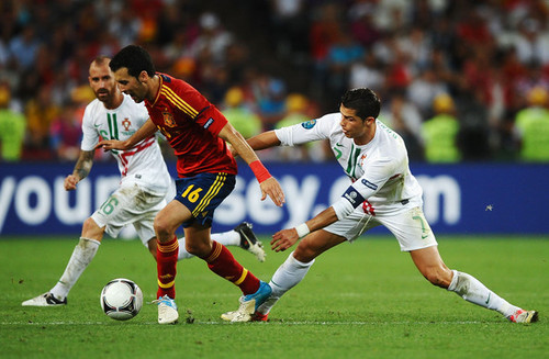 UEFA Euro 2012 wallpaper containing a soccer ball, a soccer player, and a fullback titled Portugal v Spain