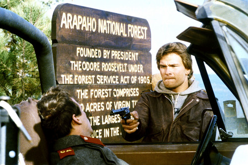 Patrick Swayze wallpaper containing a sign and a street titled Red Dawn