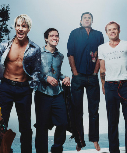 Red Hot Chili Peppers wallpaper containing a business suit, a well dressed person, and a pantleg called Red Hot Chili Peppers