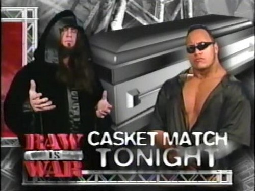 Undertaker achtergrond probably containing sunglasses entitled The Undertaker vs The Rock, Casket Match Card, 1999