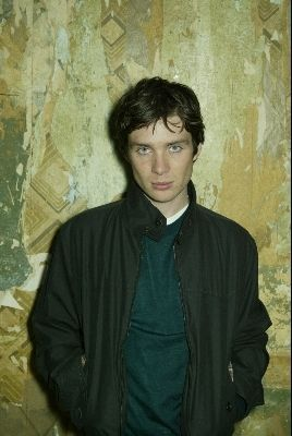 Cillian Murphy wolpeyper probably containing a surcoat and an outerwear called young&beautiful.
