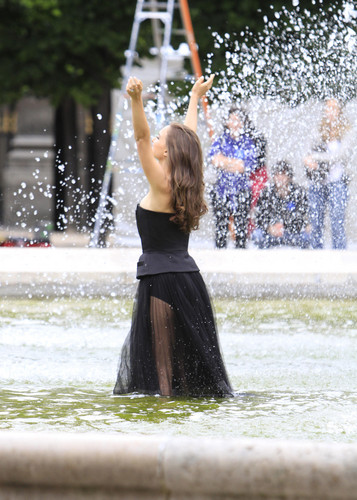 Modeling for a Miss Dior campaign picha shoot in the gardens of the Palais-Royal in Paris (June 26t