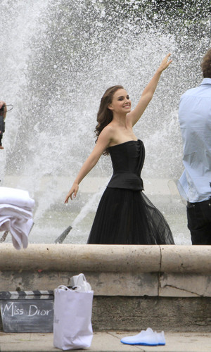 Modeling for a Miss Dior campaign photo shoot in the gardens of the Palais-Royal in Paris (June 26t