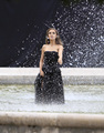 Modeling for a Miss Dior campaign चित्र shoot in the gardens of the Palais-Royal in Paris (June 26t