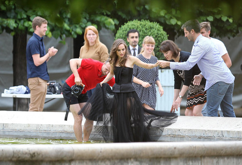 Modeling for a Miss Dior campaign 사진 shoot in the gardens of the Palais-Royal in Paris (June 26t