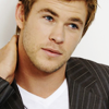 Chris Hemsworth photo containing a business suit, a portrait, and a well dressed person titled Chris Hemsworth