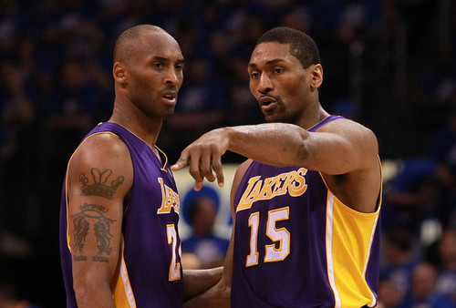 Los Angeles Lakers wallpaper probably with a basketball player and a dribbler titled Metta World Peace and Kobe Bryant