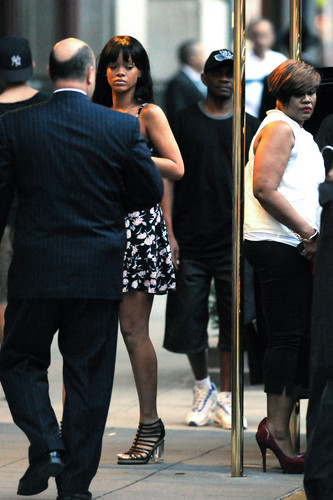 Rihanna wallpaper containing a revolving door called Pays Tribute To Her Grandmother In New York City [5 July 2012]