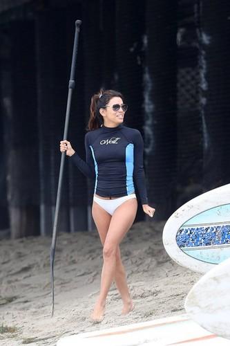 Eva Longoria paddle boarding in Malibu