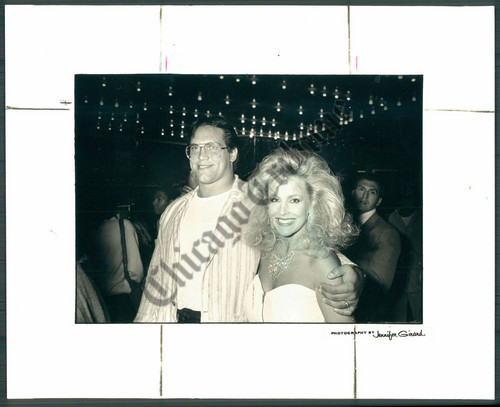 Former WWE Diva... Debra achtergrond probably containing a newspaper and a sign titled A Young Debra with then husband Steve McMichael in 1987