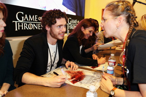 Game of Thrones wallpaper probably containing a brasserie, a bistro, and a dinner called Game of Thrones Cast @ Comic-Con 2012