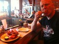 George eating a plate of wings in AC