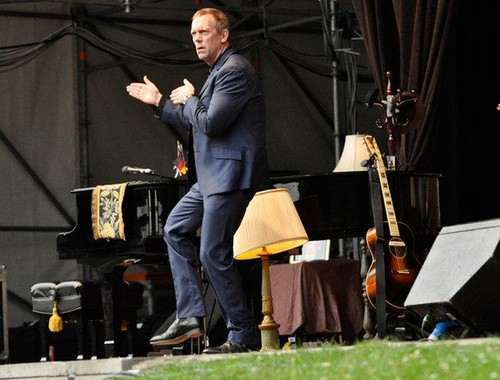 "Hugh Laurie achtergrond containing a business suit and a concert entitled Hugh Laurie concert at the ""Stadtpark Freilichtbühne"" - Hamburg 15.07.2012"
