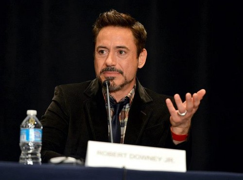 Robert Downey Jr. wallpaper probably containing a business suit entitled Iron Man 3 at San Diego Comic-Con