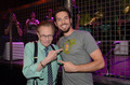 Larry King and Zachary Levi