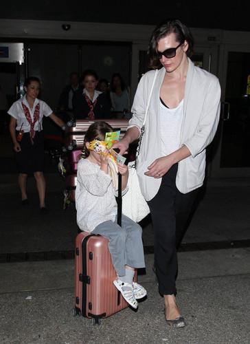 Milla Jovovich And Ever Land In LA [July 10, 2012]