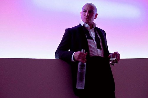 Pitbull Rapper Wallpaper With A Business Suit And Well