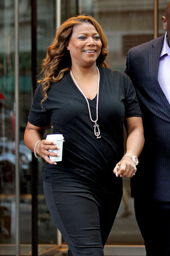 queen Latifah is spotted leaving her hotel in New York City carrying a coffee [July 11, 2012]
