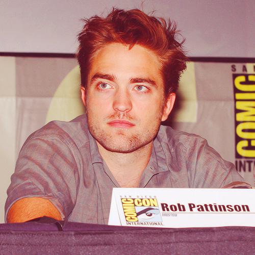 Robert Pattinson wallpaper possibly with a sign and a newspaper entitled Robert