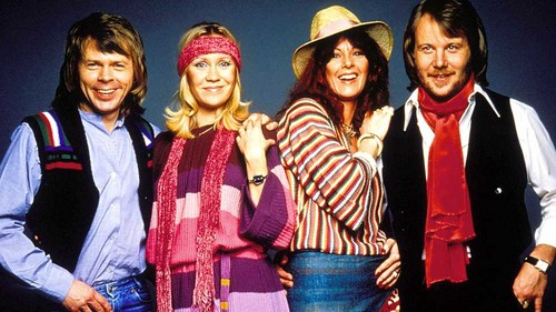 ABBA wallpaper probably containing an outerwear and a well dressed person called ABBA