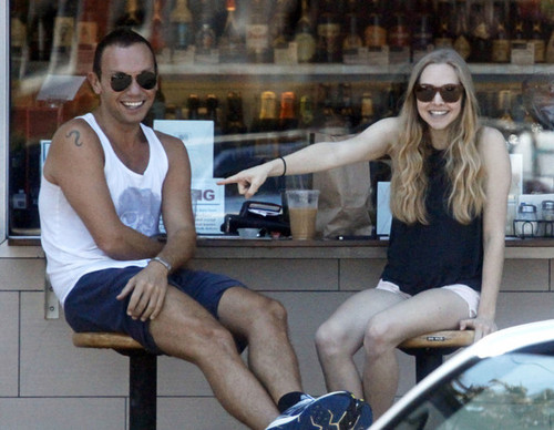 Amanda Seyfried wallpaper containing sunglasses entitled Amanda Seyfried Meets Friends At Oaks Gourmet Market [July 17]