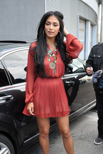 Nicole Scherzinger wallpaper containing a hip boot titled Arriving At The X Factor Boot Camp In Liverpool [20 July 2012]