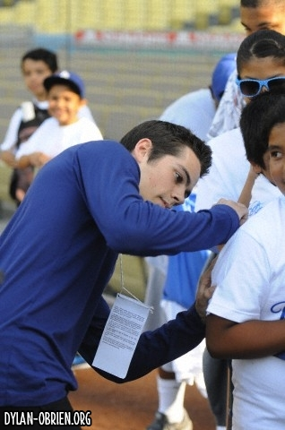 Dylan O'Brien پیپر وال probably containing a وکٹ and a بولر, گیند باز titled Catching The First Pitch At Dodger's Game