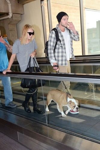 Miley Cyrus - At Philadelphia International Airport [17th July] - miley-cyrus Photo