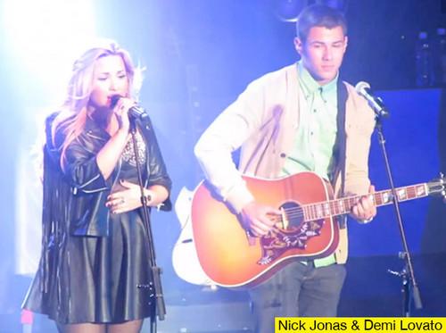 Nick Jonas accompanies Demi Lovato on stage