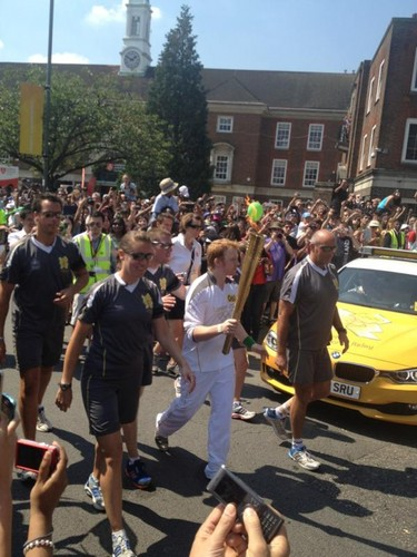 Rupert Grint carrying the Olympic Torch.
