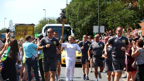 Rupert Grint carrying the Olympic Torch. - rupert-grint Photo