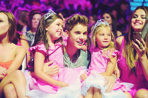 Justin Bieber and Selena Gomez wallpaper possibly containing a bridesmaid and a portrait called Selena & Justin at TCAS 2012