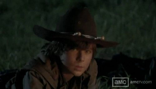 Chandler Riggs Hintergrund probably containing a rifleman, a green beret, and a boater entitled carl