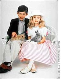 jonbenet ramsey wallpaper possibly with a well dressed person, a living room, and a cat called JonBenet and her brother Burke