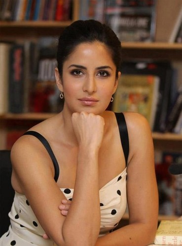 Katrina Kaif wallpaper probably containing a bookshop, an athenaeum, and a library entitled Katrina thiinks somethiing...
