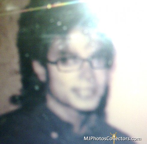 MJ wearing glasses