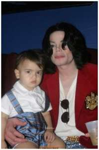 "Michael Jackson wallpaper containing a portrait titled Michael And Youngest Son, ""Blanket"""