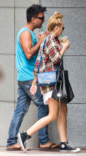 Miley Cyrus wallpaper with a hip boot titled Out In Philadelphia [27 July 2012]
