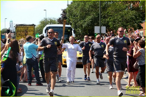 Rupert Grint carring the Olympics Torch
