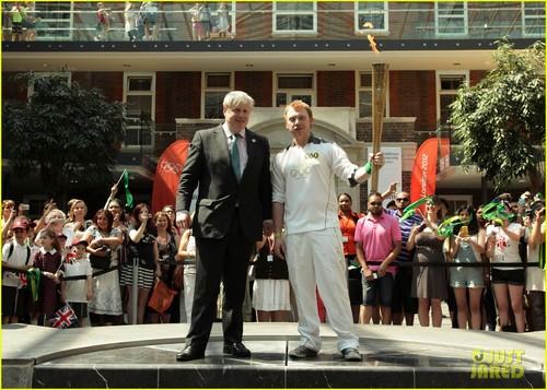 Rupert Grint carring the Olympics Torch