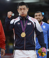S.korean Song Dae-Nam wins gold in olympic men's 90-kg judo. - the-olympics photo