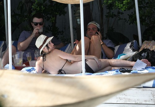 Katy Perry wallpaper titled Wearing A Bikini At A Hotel Pool In Miami [26 July 2012]