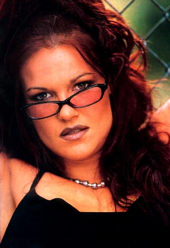"Amy ""Lita"" Dumas wallpaper with a chainlink fence titled lita"